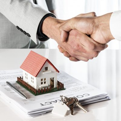 people-shaking-hands-over-toy-model-house(1)